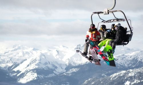 Snowboarders on chairlift at Canadian ski resort